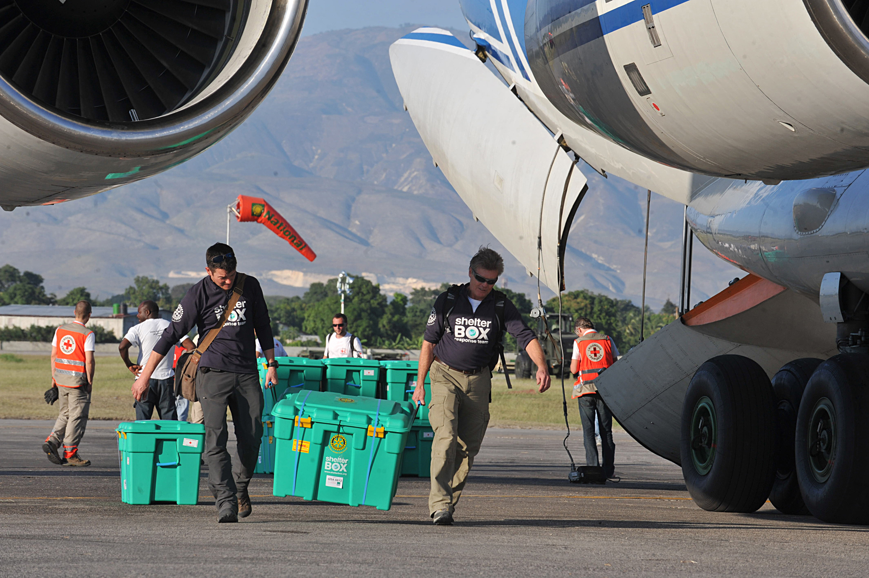 ShelterBox Response Team unloads aid in Haiti in response to the 2010 earthquake.