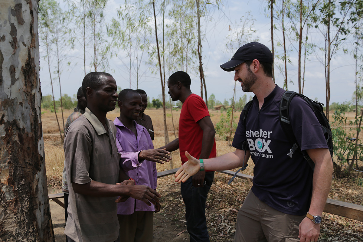 ShelterBox Response Team greets Malawi locals in 2015.