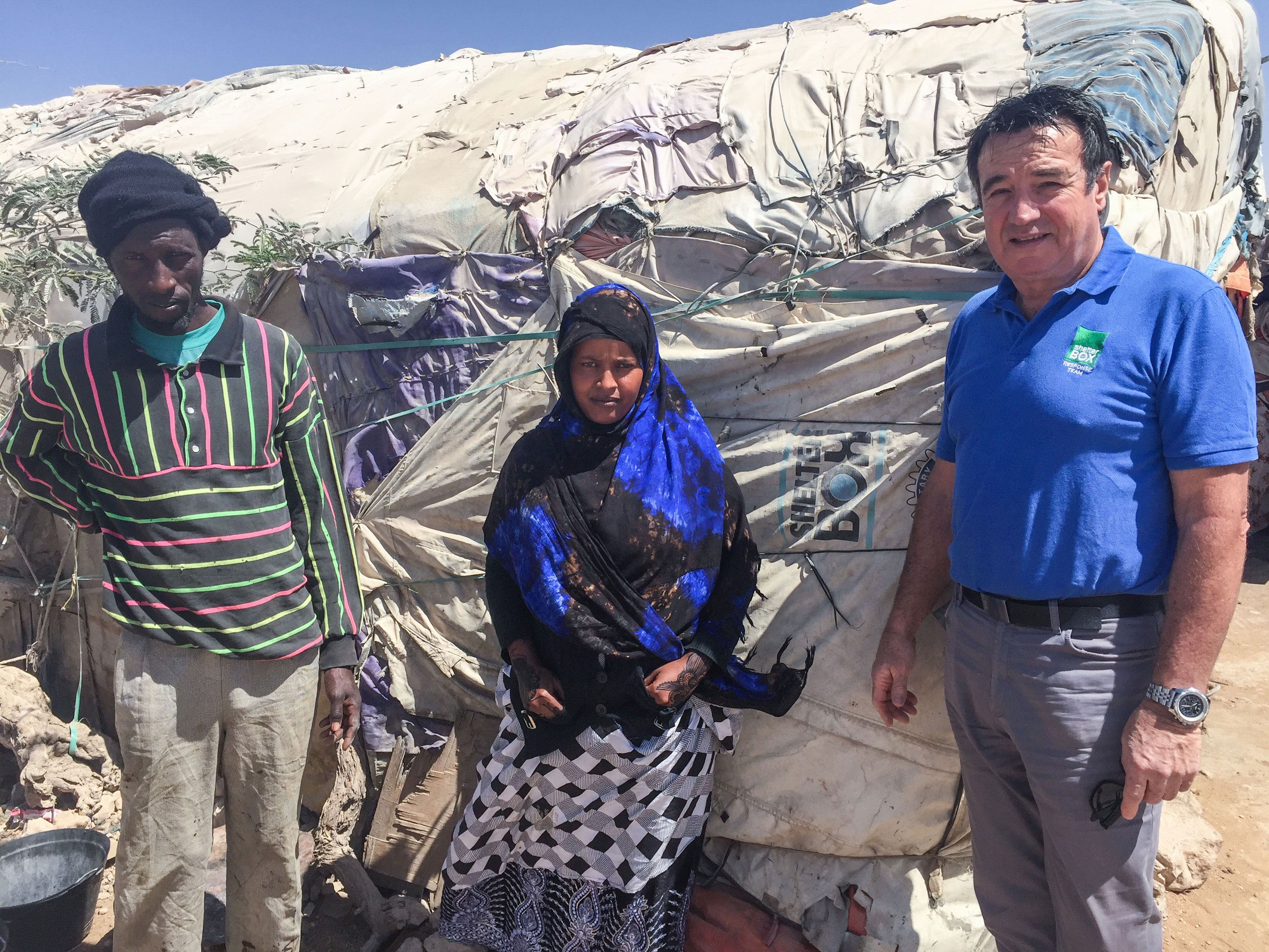 Muna Mohammed with 10 year old ShelterBox tent making up part of a much larger structure, her Café Prosperity.