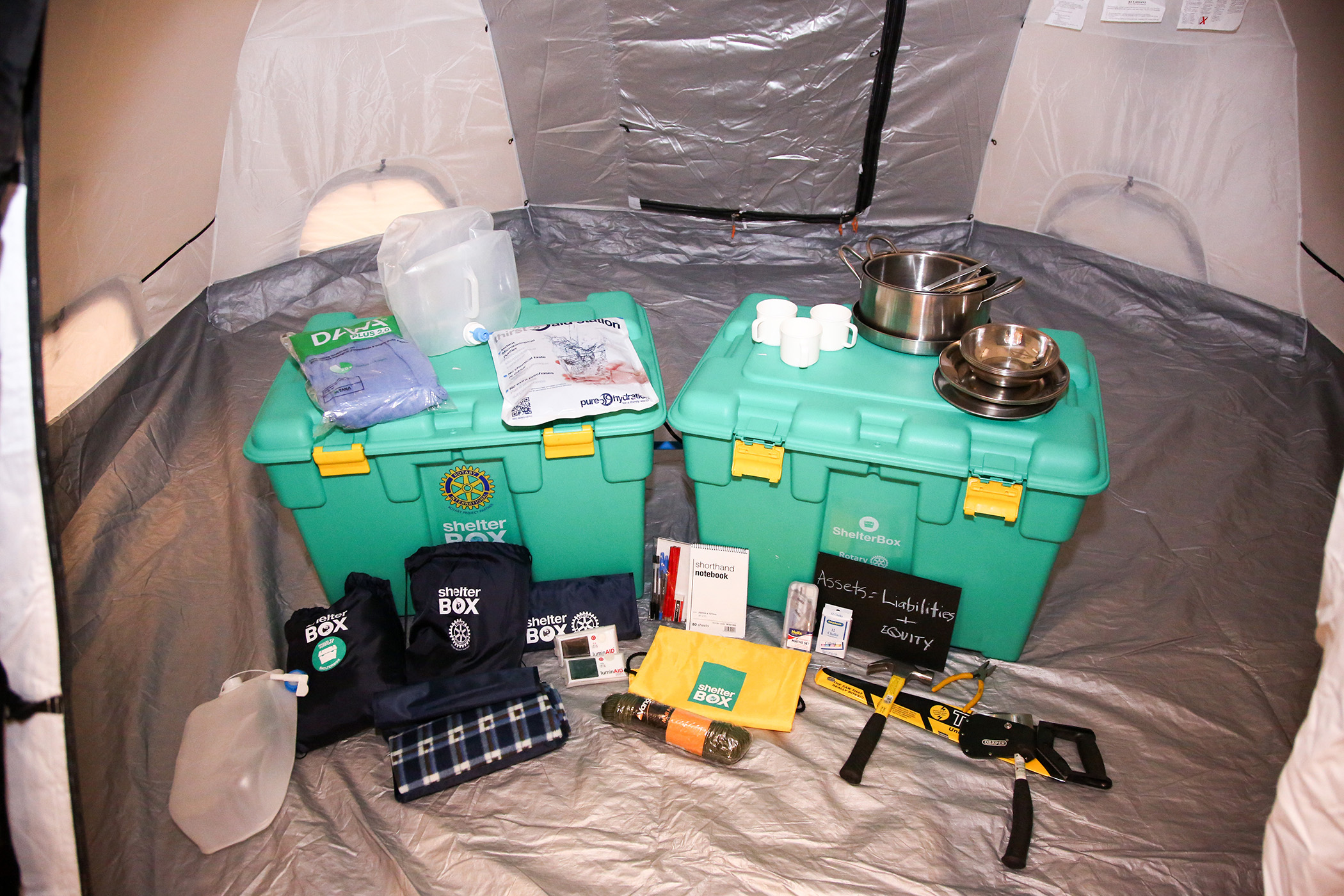 Shelter Boxes with all of the various aid items we offer