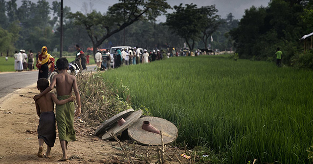 Bangladeshi people wait for aid
