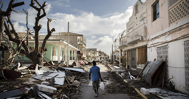 A man walks on a street covered in debris after hurricane Irma hurricane passed on the French island of Saint-Martin, near Marigot on September 8, 2017.