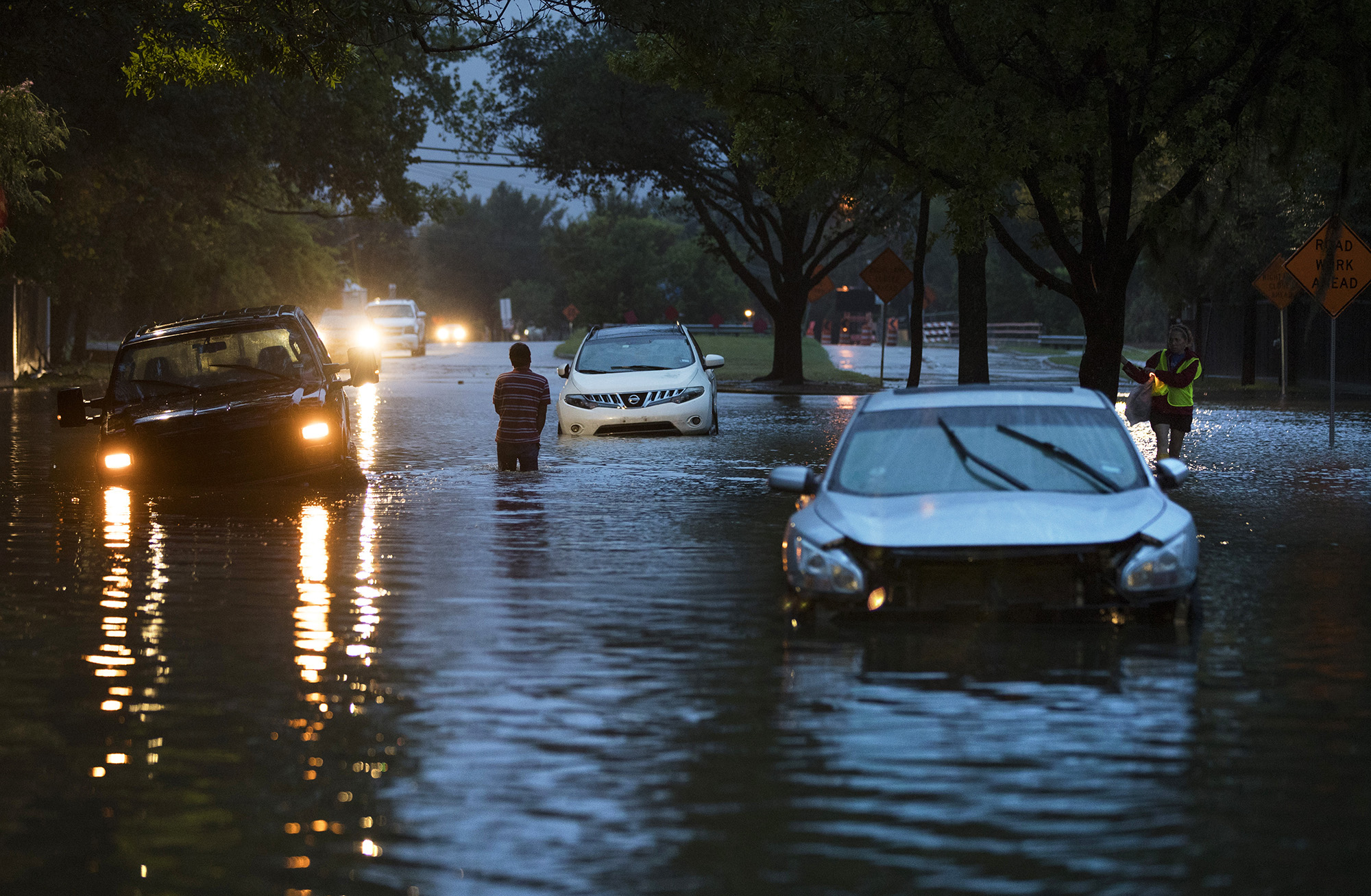 HOUSTON, TX - AUGUST 28: Stranded vehicles sit where they got stuck in high water from Hurricane Harvey on Voss Road in Houston, Texas August 28, 2017. (Photo by Erich Schlegel/Getty Images)