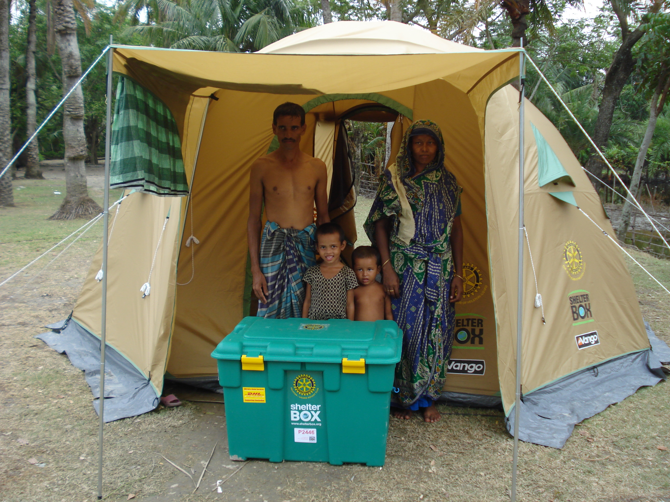 Family in golden ShelterBox tent