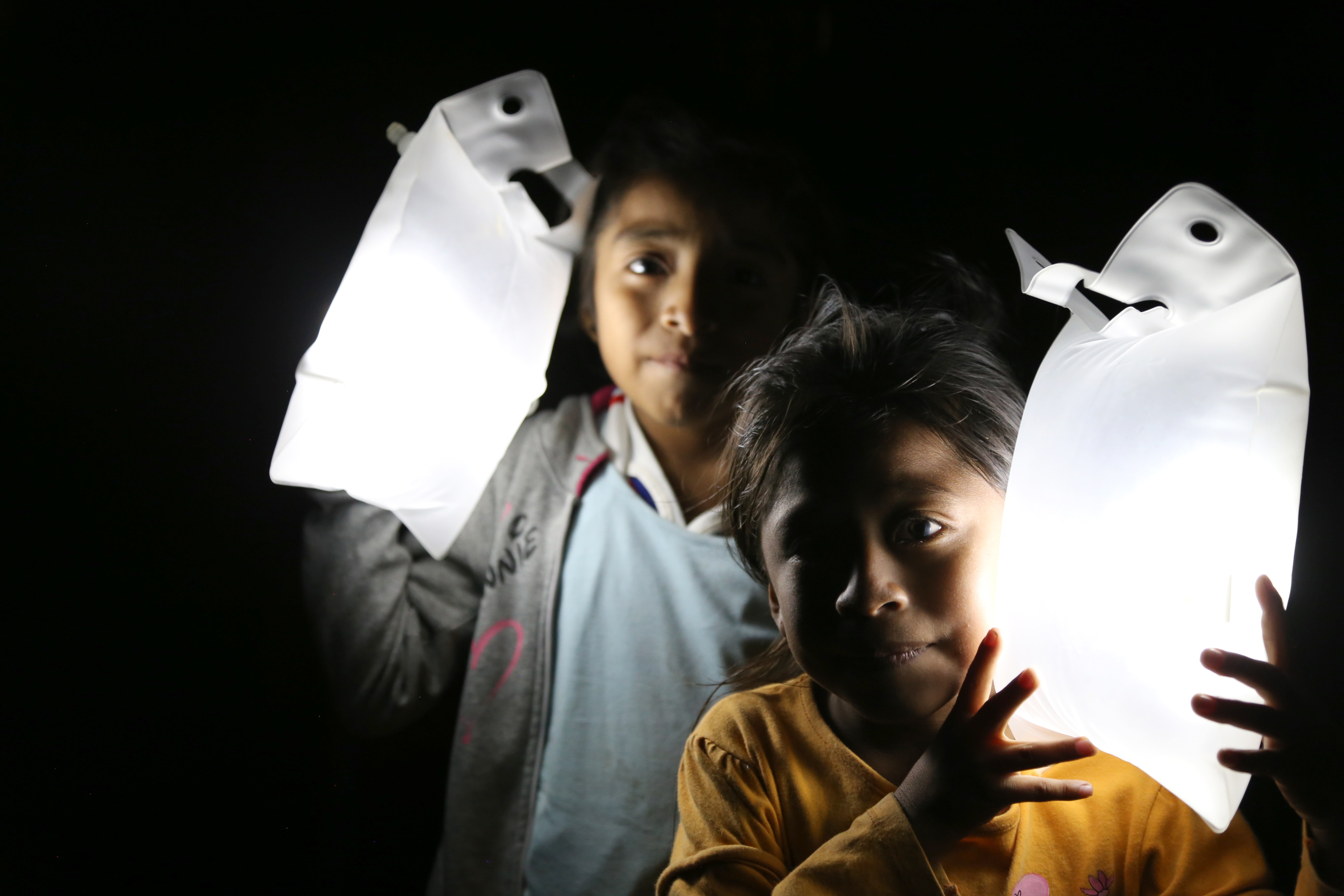 Children showing the Large size solar lights in the dark