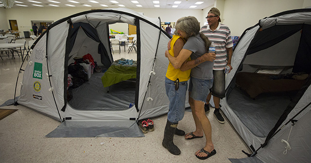ShelterBox set up privacy tents in the American Legion Post 658 as they respond to the aftermath of Hurricane Harvey. Donald Koonce get a hug from friend Cindy Crow after moving into their