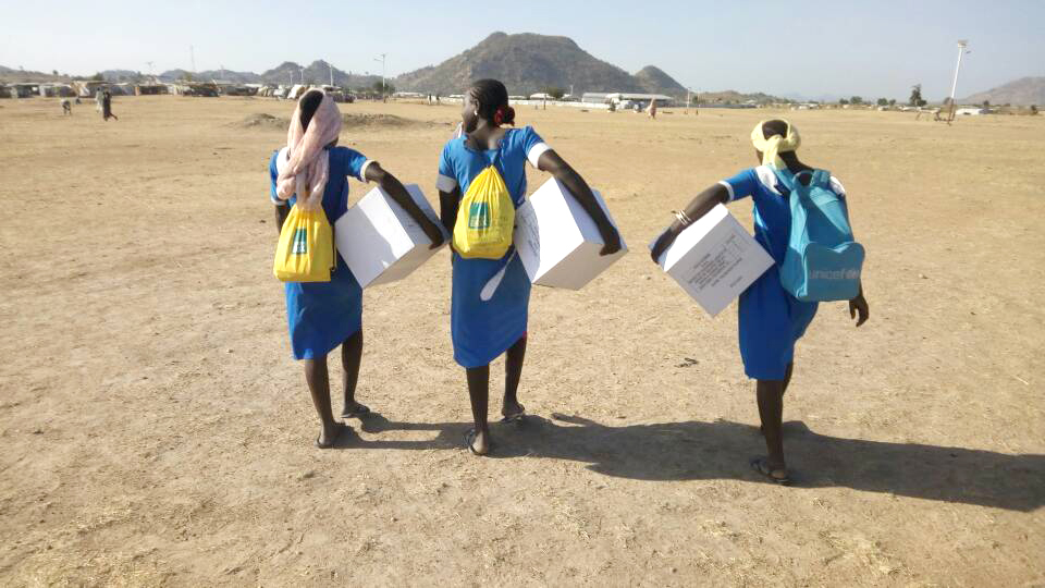 Carrying aid items across the dry landscape