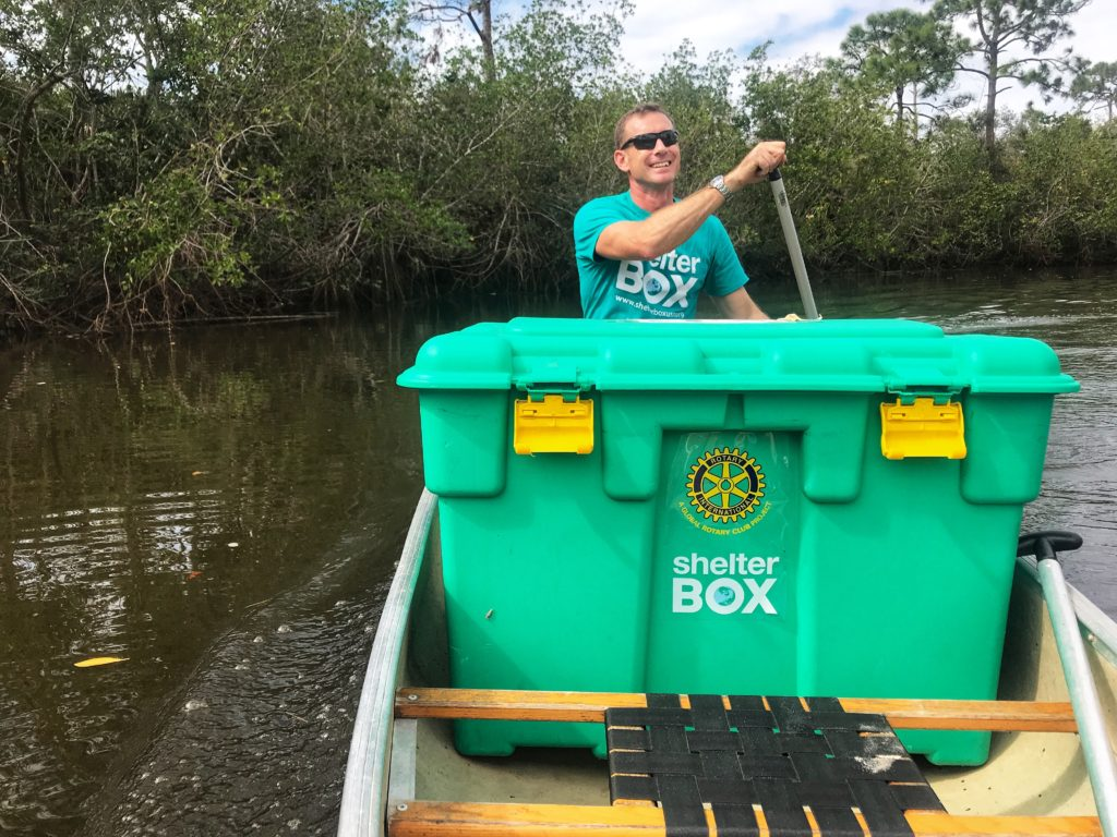 Erik paddling in canoe with his ShelterBox