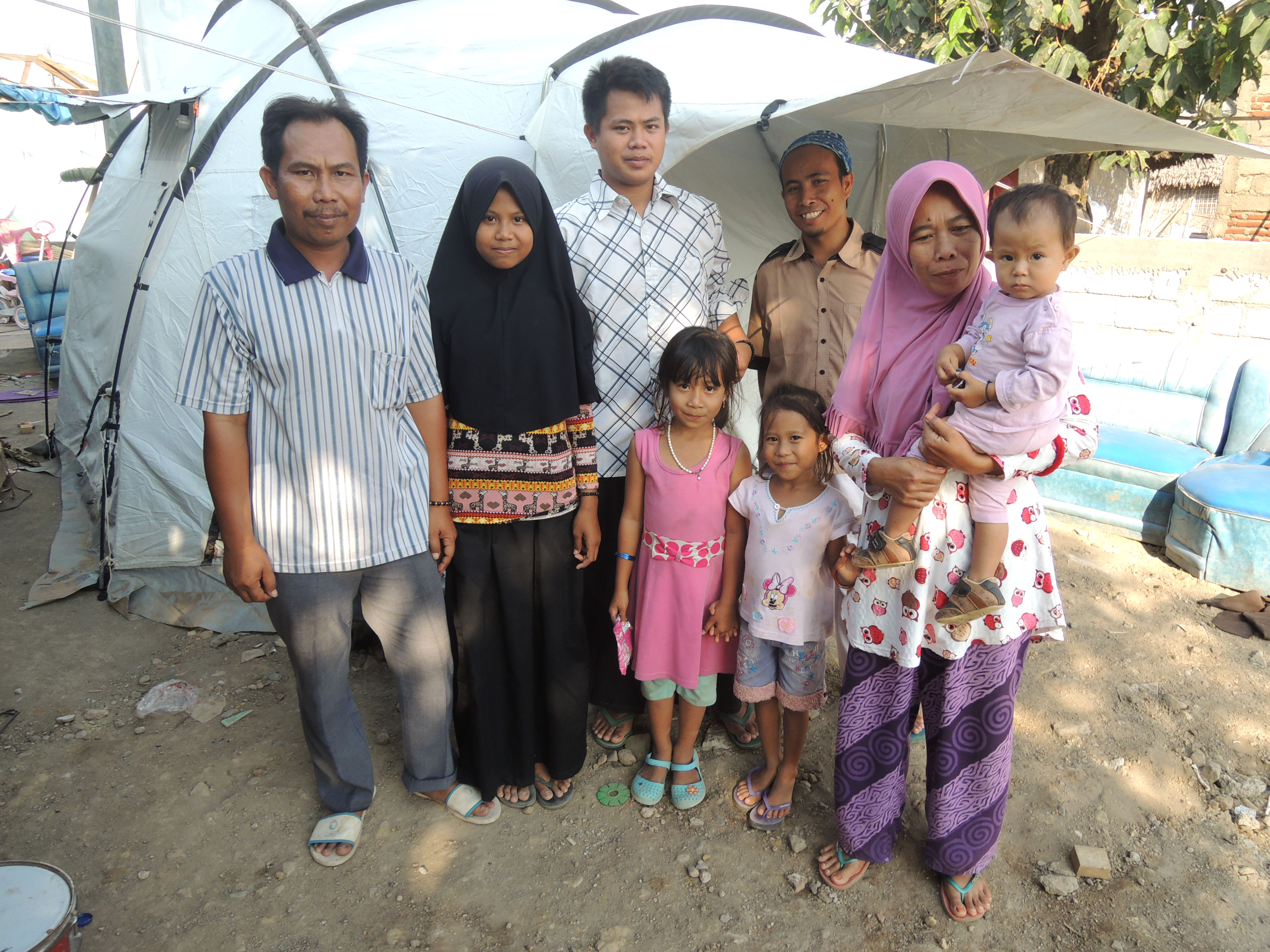 Ahmed and his children with their tent.