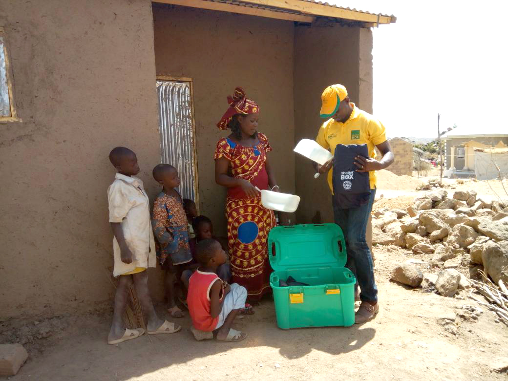 Catherine receiving her ShelterBox