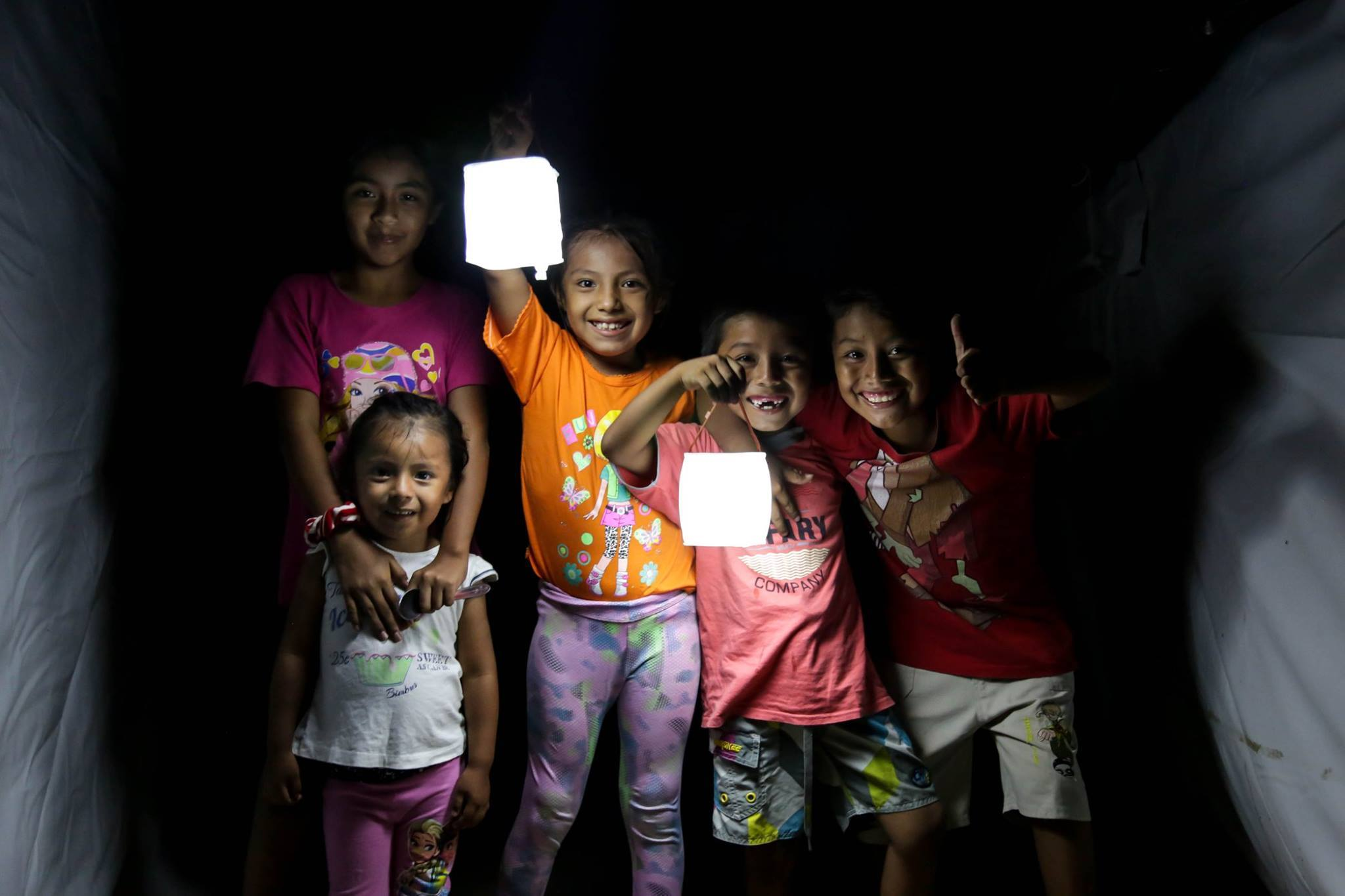 Kids lighting up the night with LuminAid