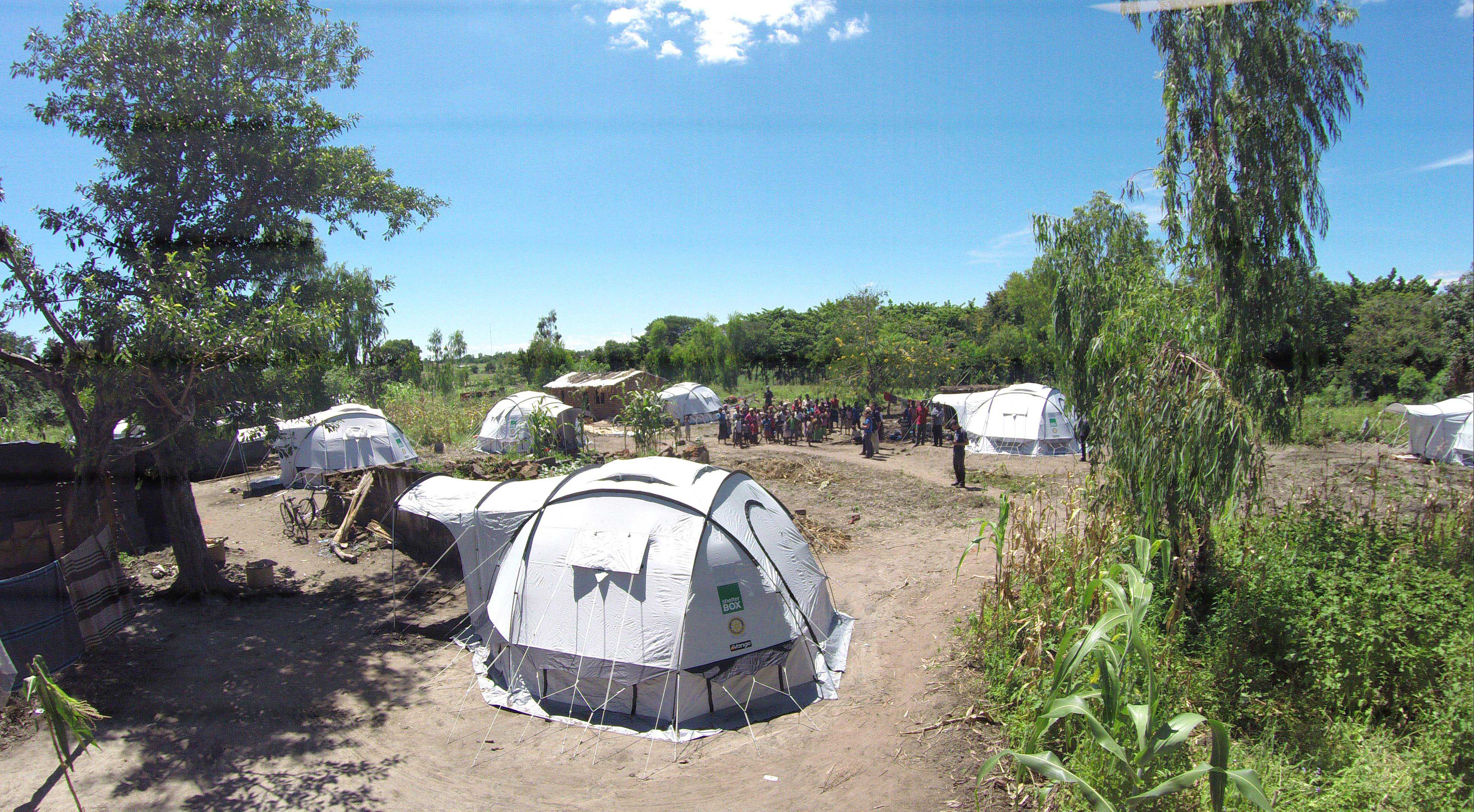 Tents in a field on a bright day in Malawi