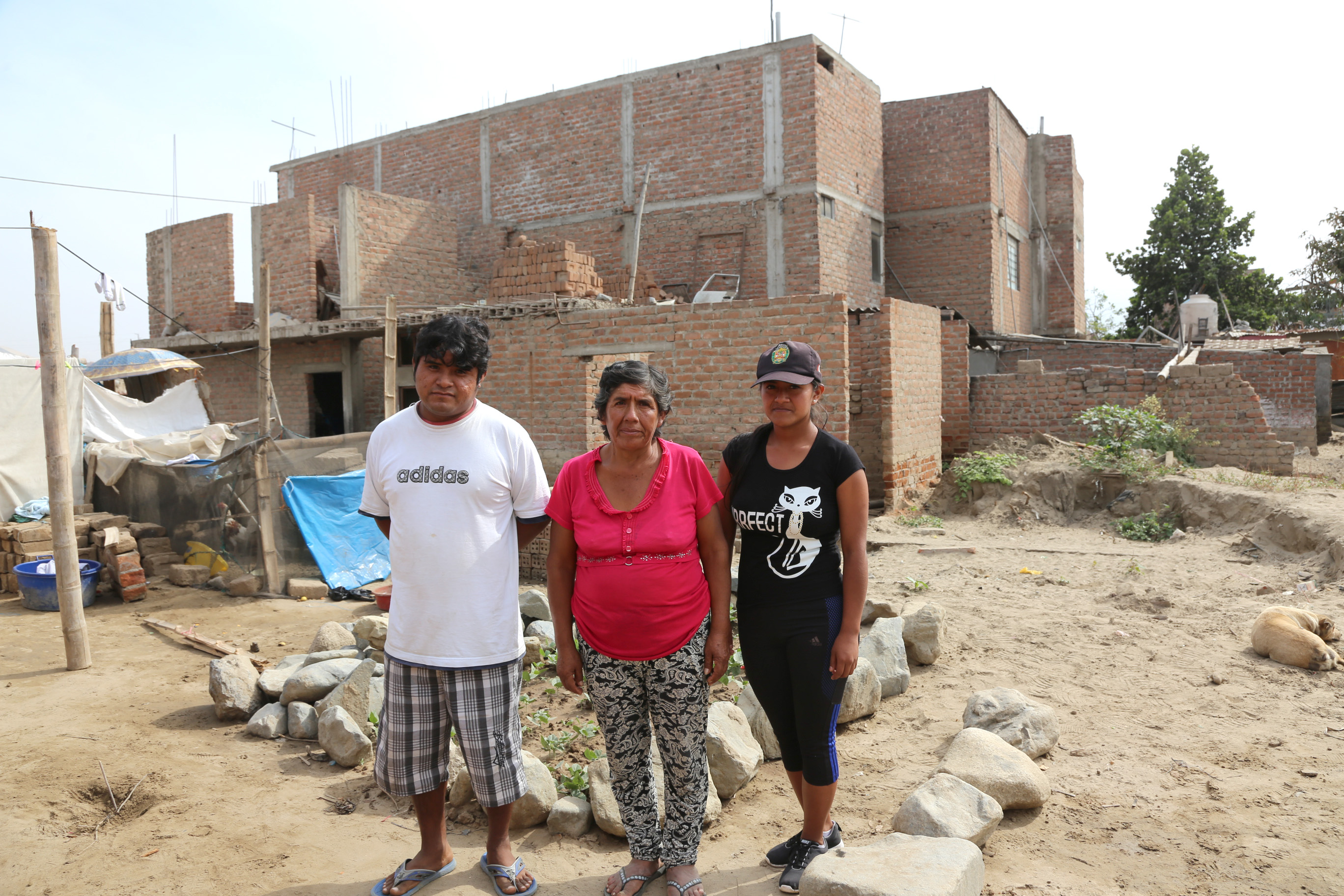 Julia and family on the site of where their home once stood