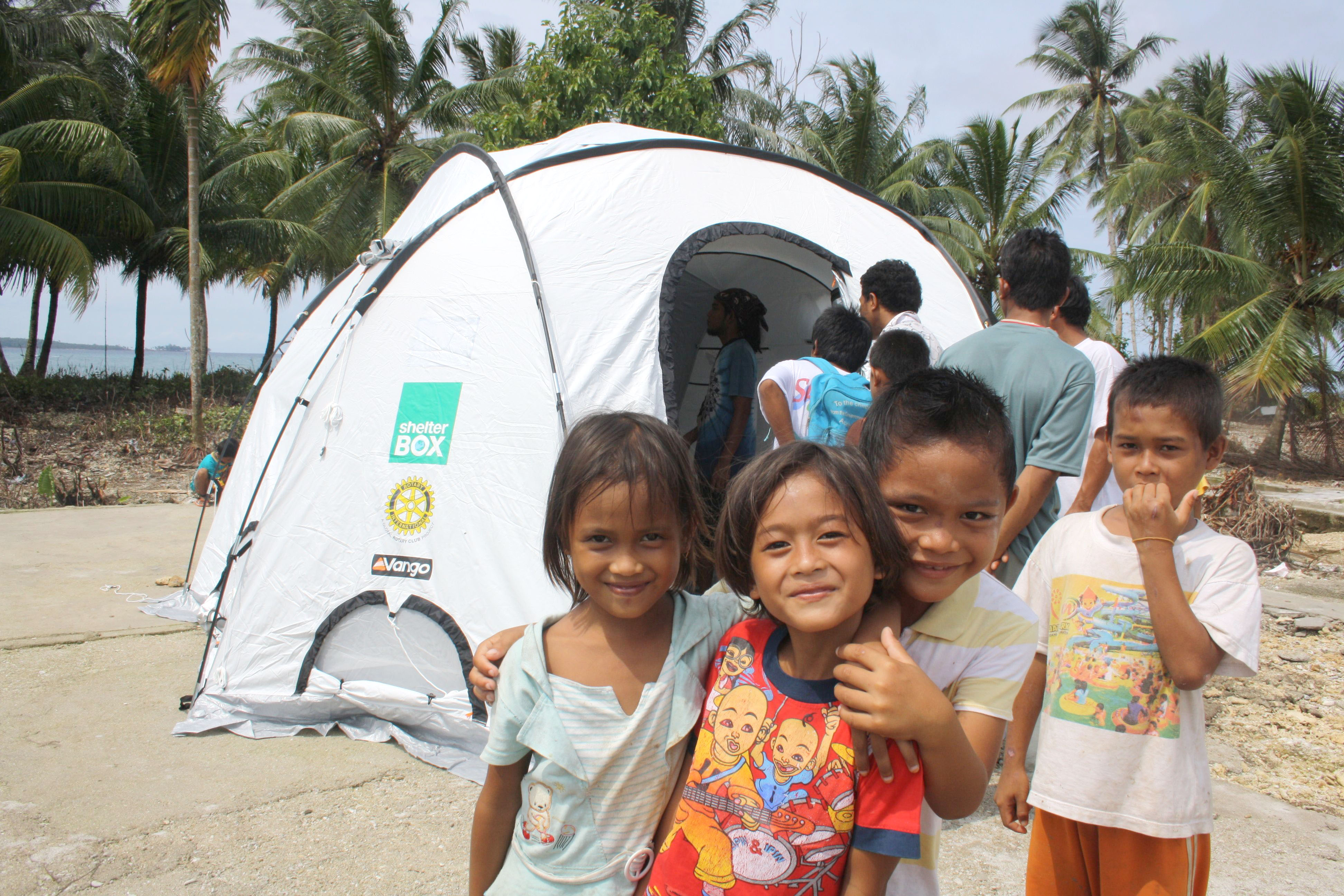 Children on the beach outside tent