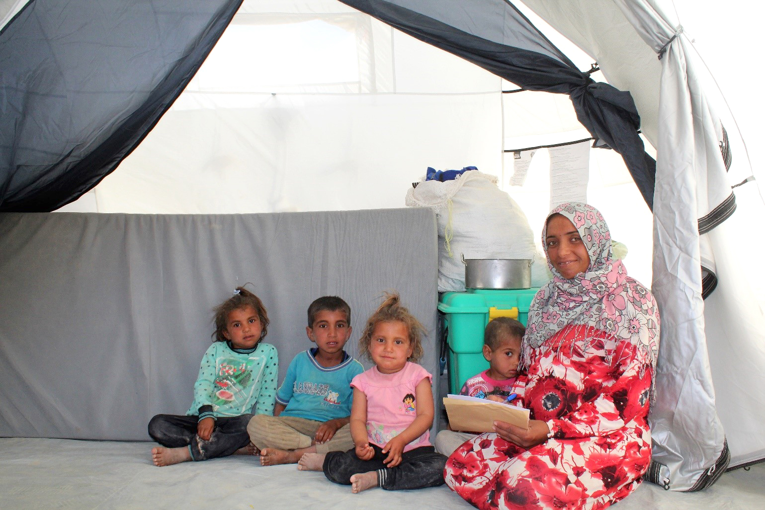 Ali and her 4 children in their tent