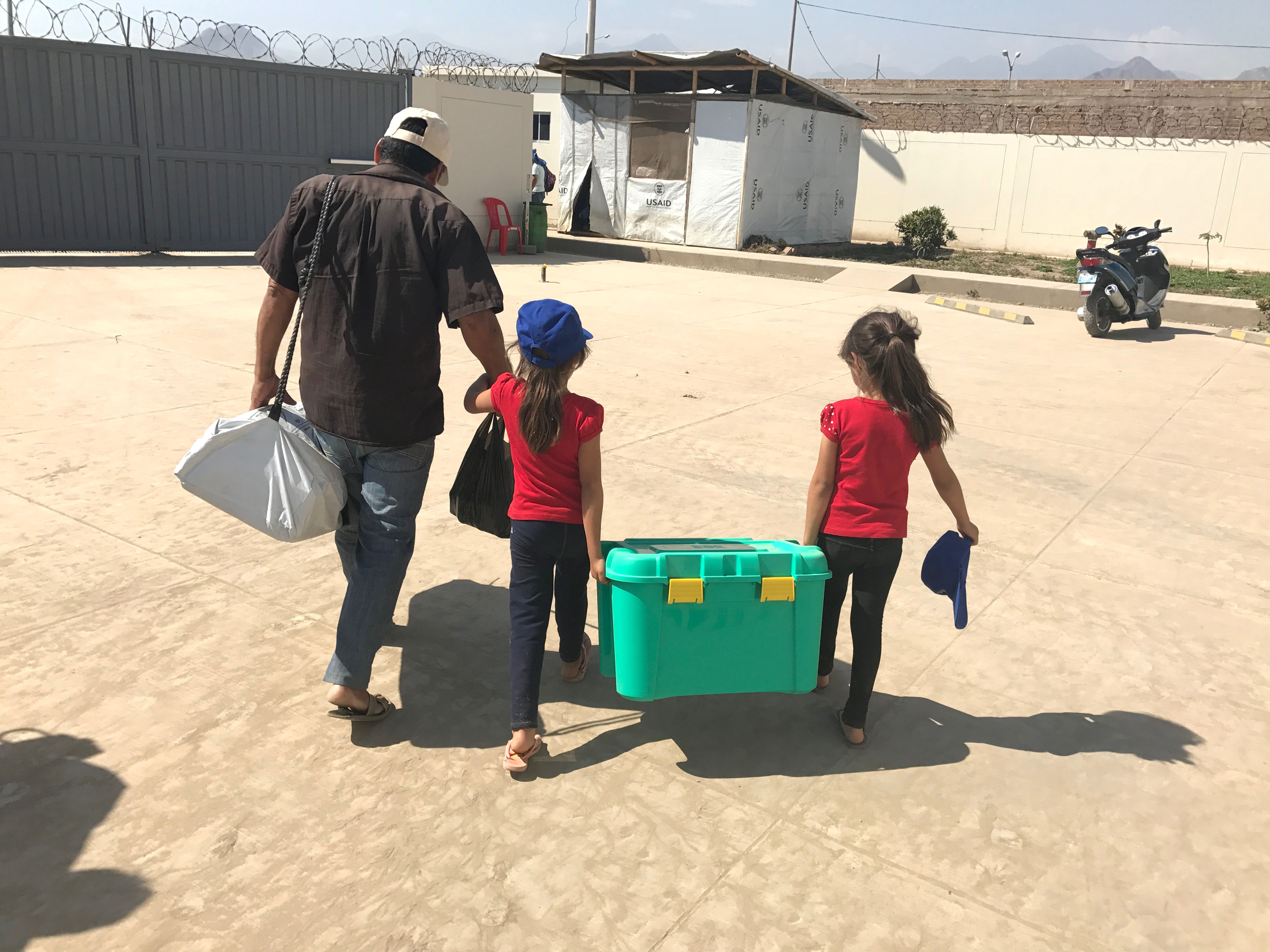 Carrying a shelterkit across the camp grounds