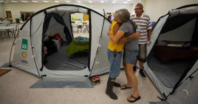Hugging after Hurricane Harvey