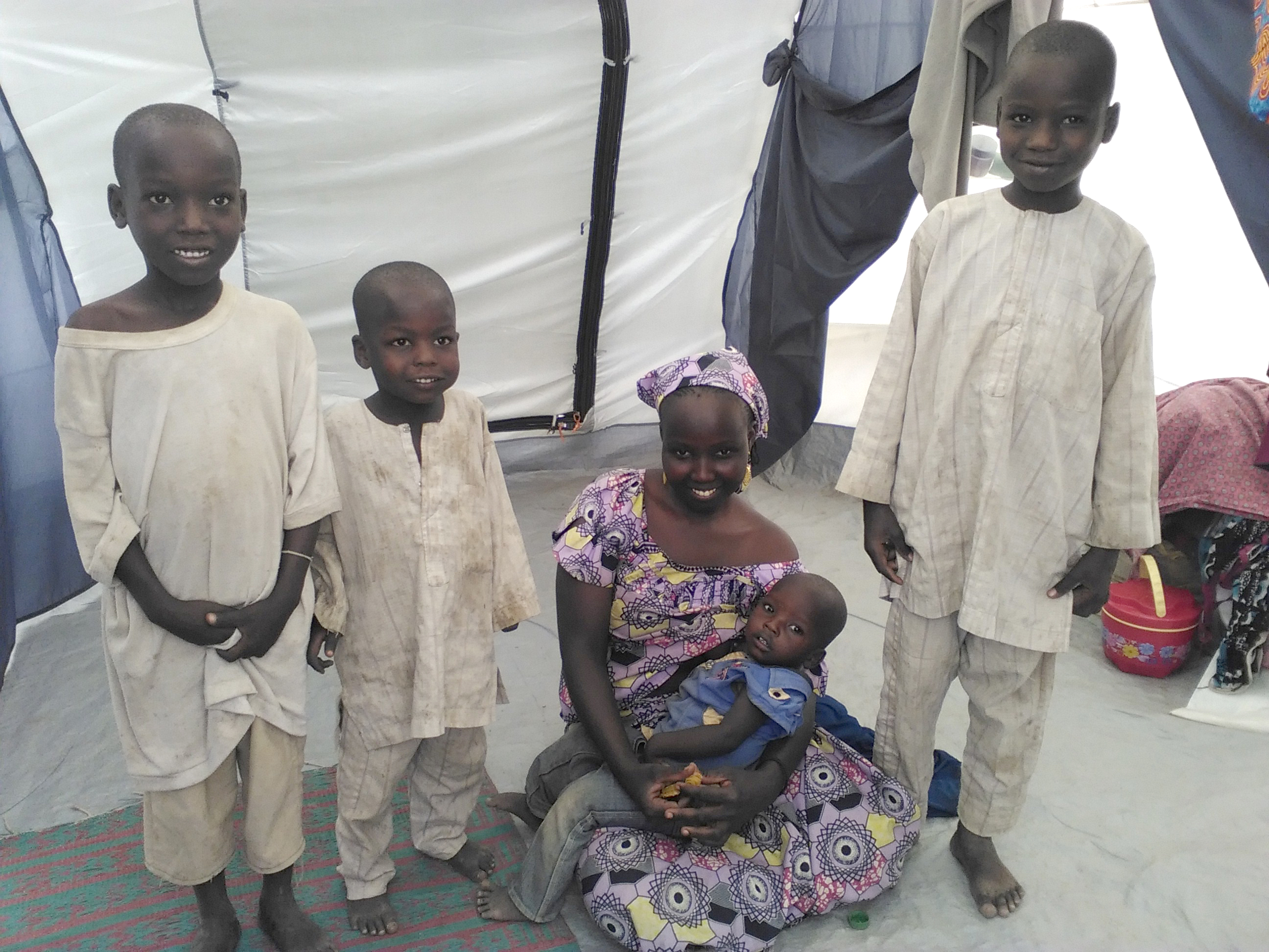 Modu and her four children pose for a family photo