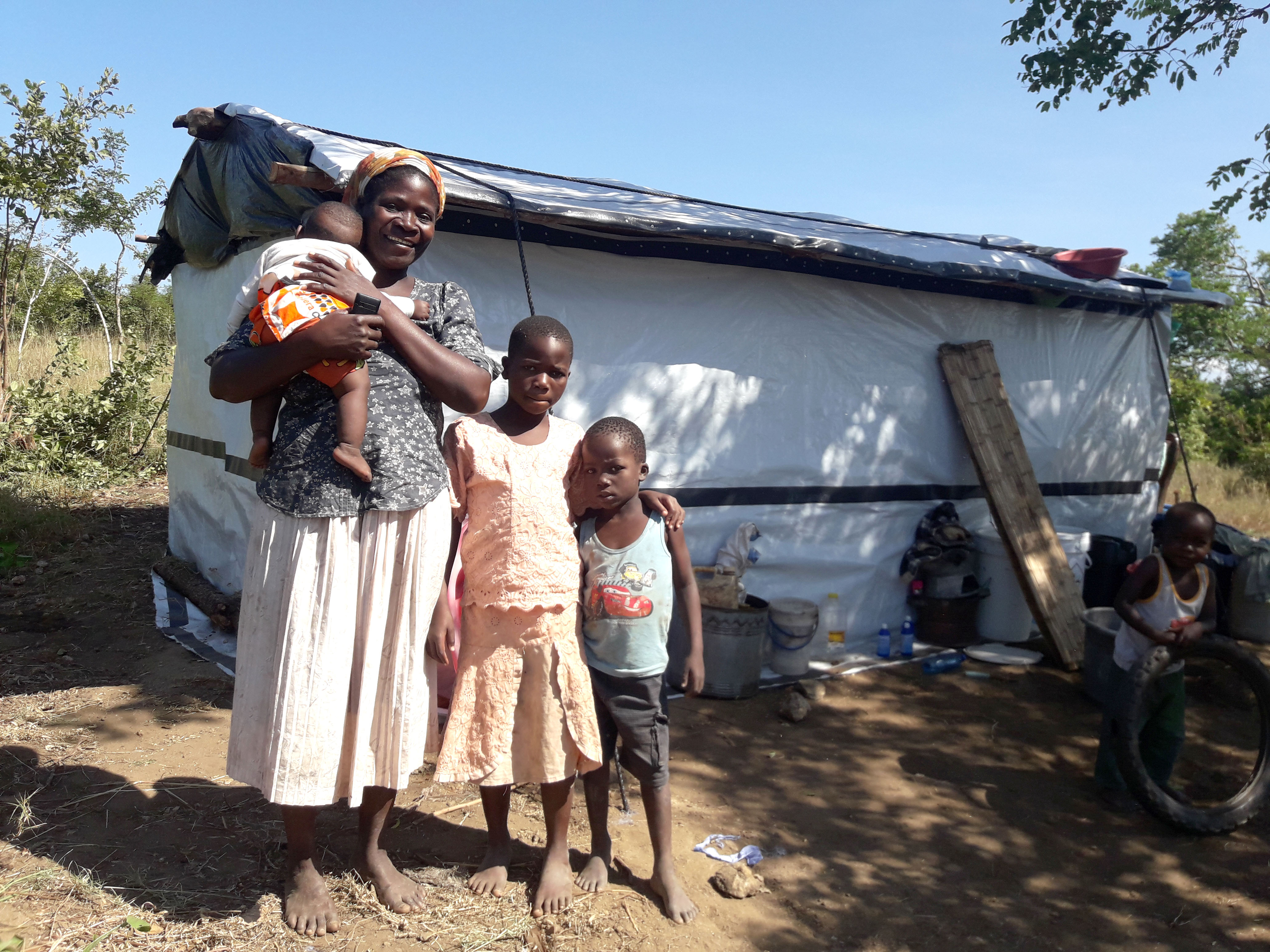 Grace and family outside their home