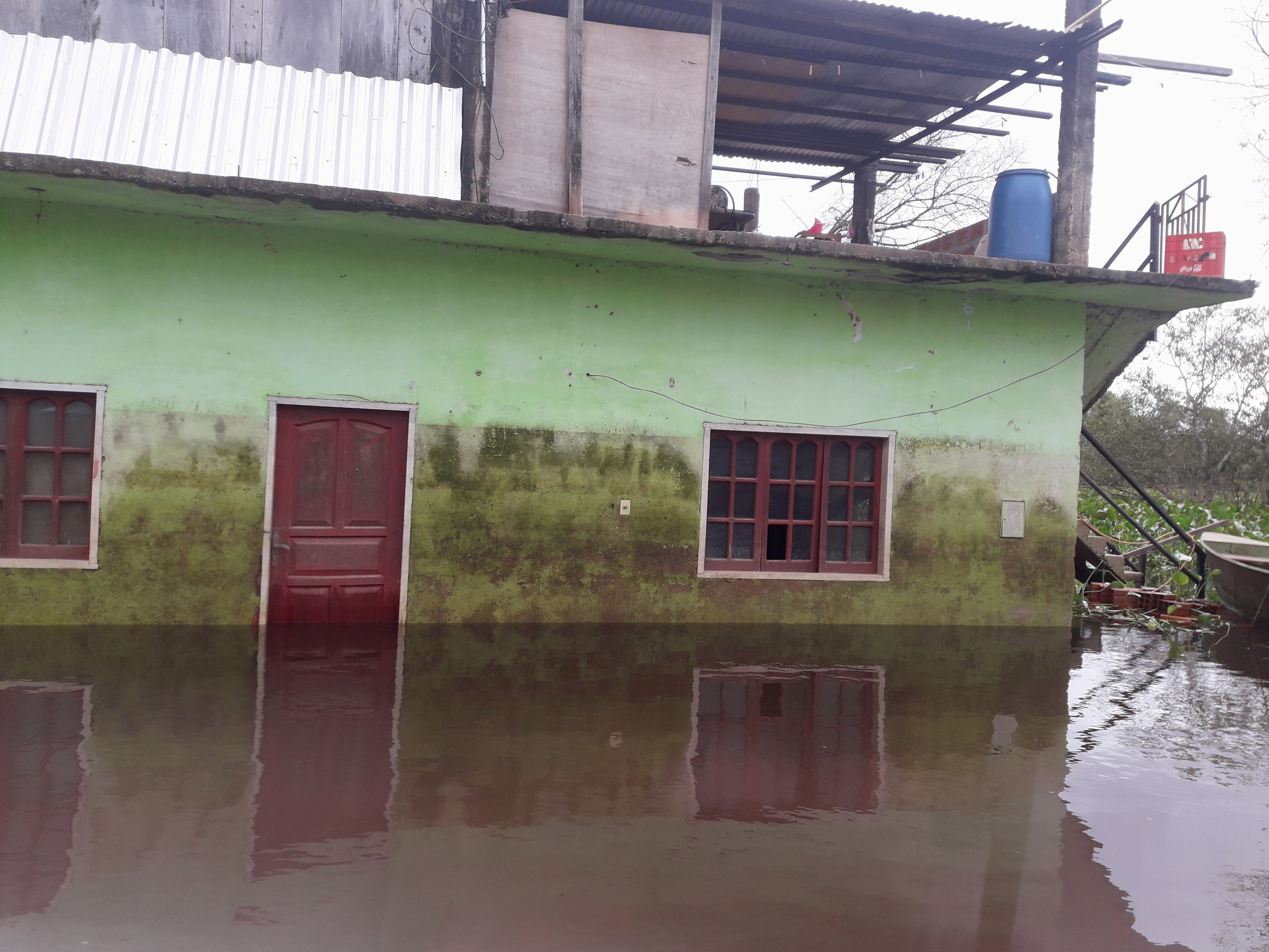 Small Building standing in thigh-high water