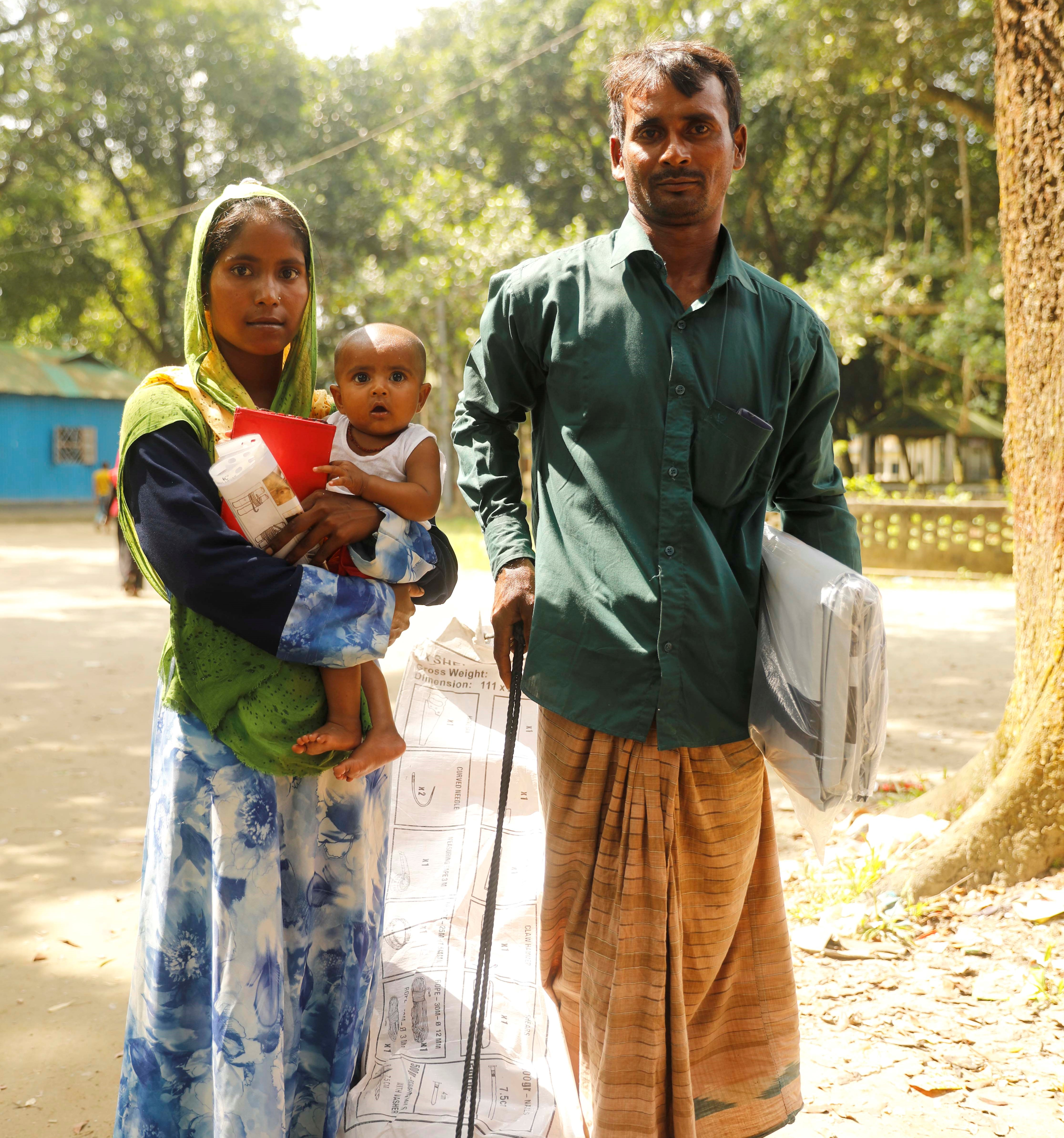 Couple with child and aid items