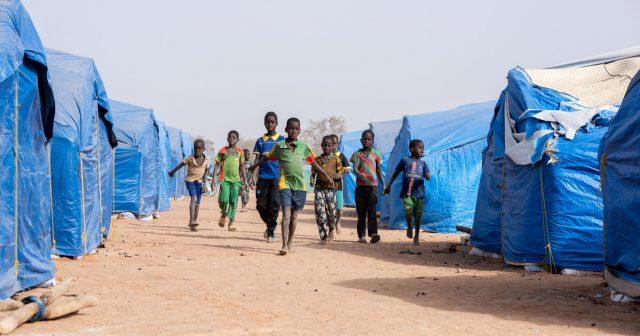 Kids running through a camp - Burkina Faso Conlfict