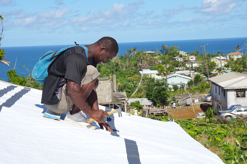 Repairing the roof in Dominica after Hurricane Maria