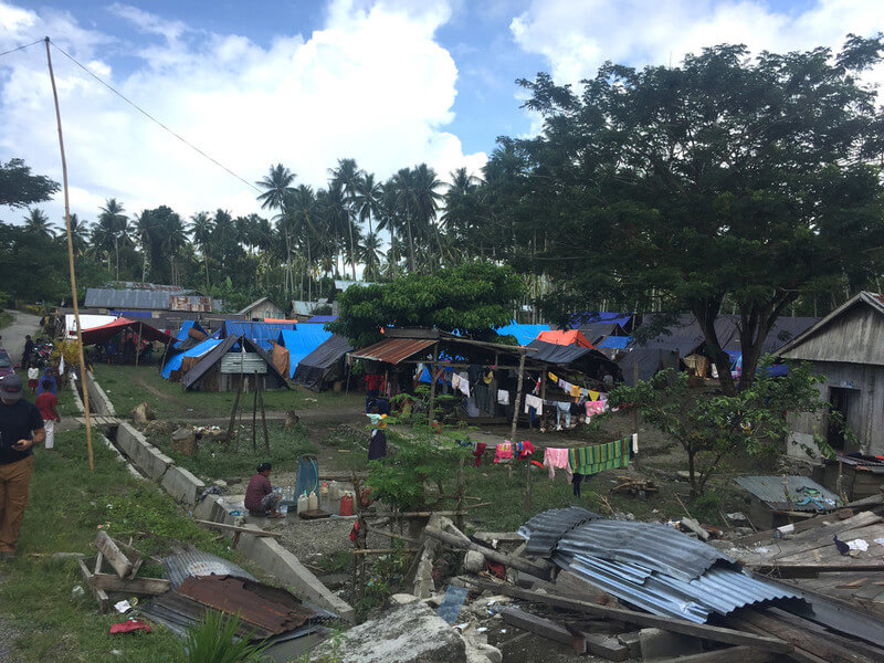 Roofs and other debris scattered across the landscape