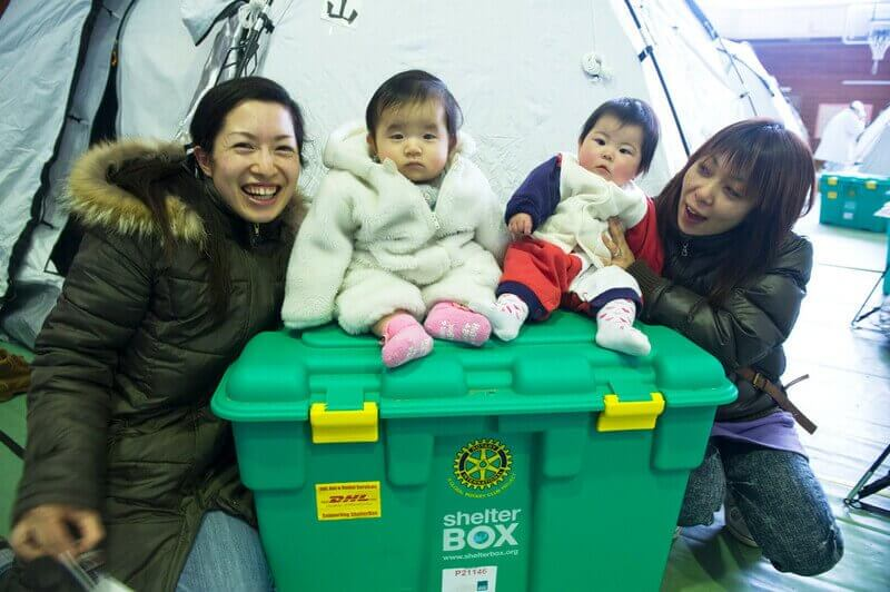 Children on top of ShelterBox