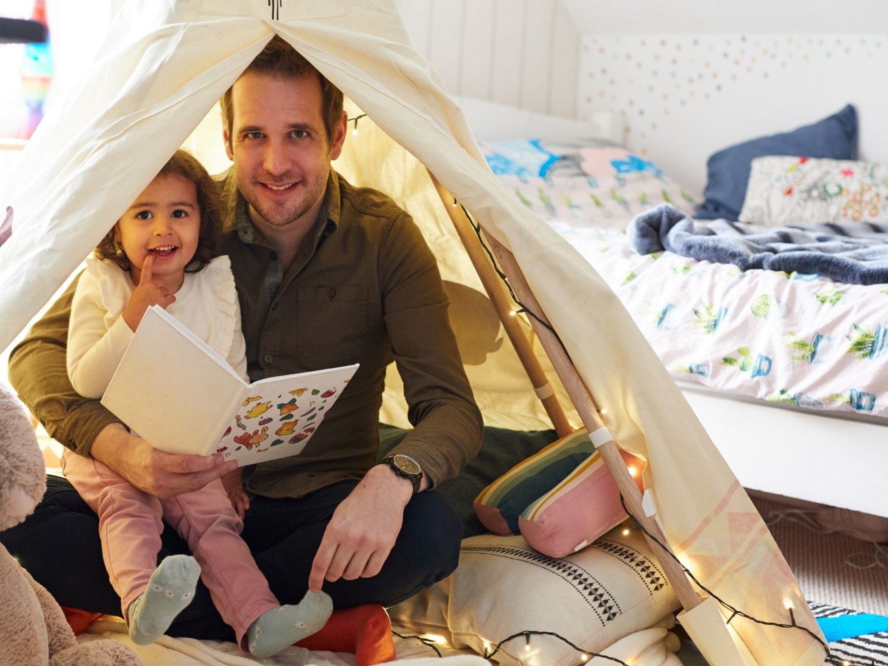Father and daughter in a homemade fort