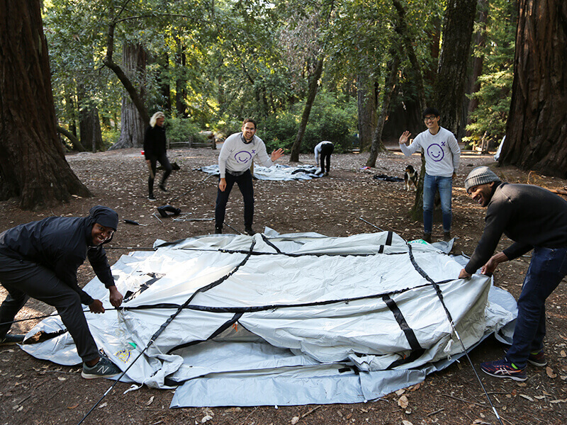 AirBnb team members setting up tent