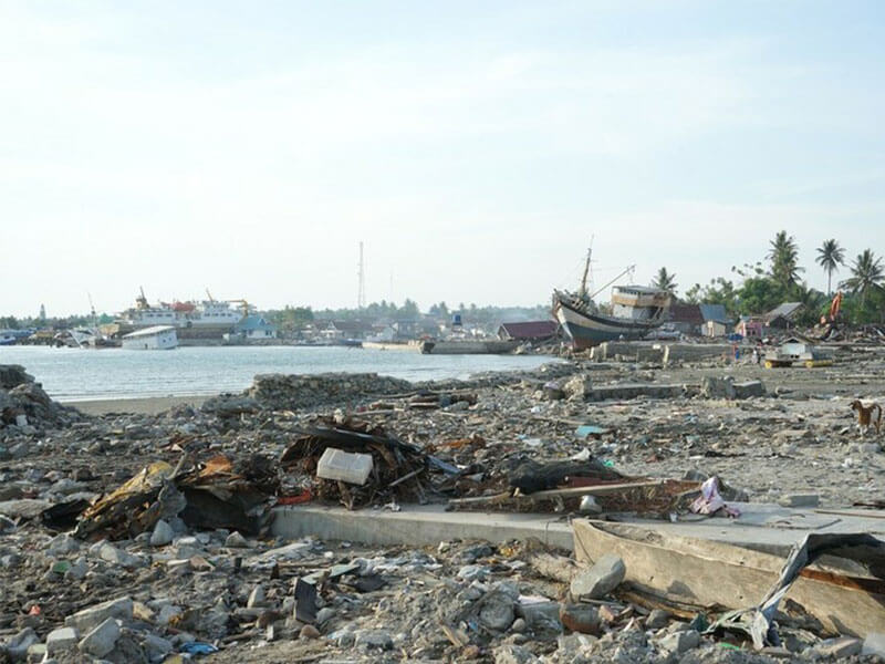 Boats and other debris washed up on the beach, Indonesia