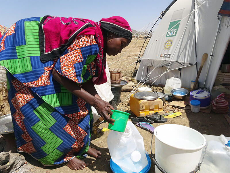 filling up a water carrier in Cameroon