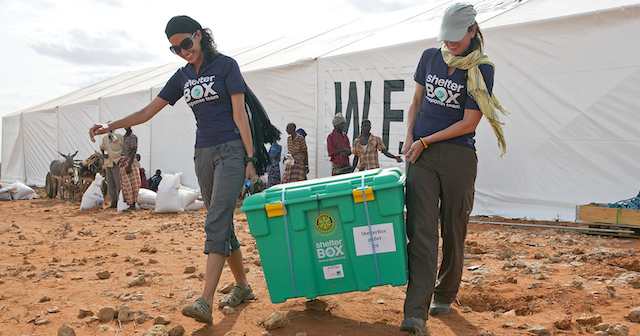 L-R Emily LoSavio (USA) and Rebecca Ridgeway (UK) carry the first of 1600 destined for Dolo Ado at the Haloweyn Refugee Camp, Somali Region, Ethiopia