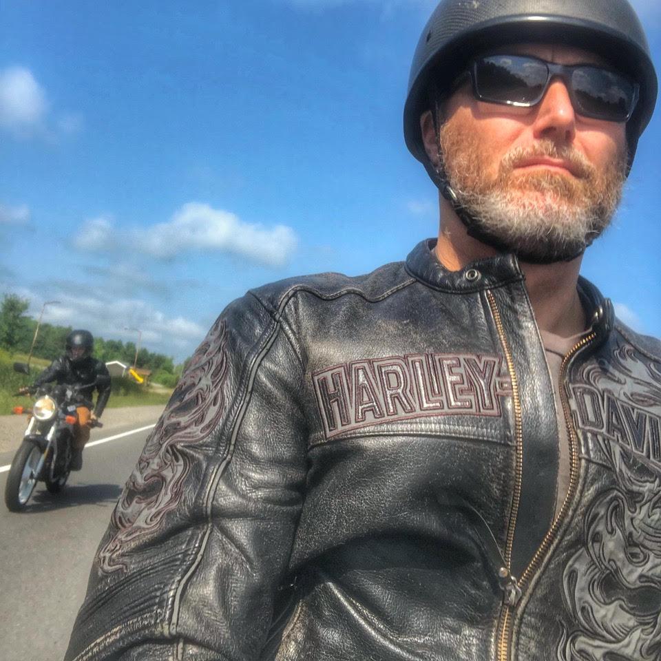 Mark on the road in full biker gear