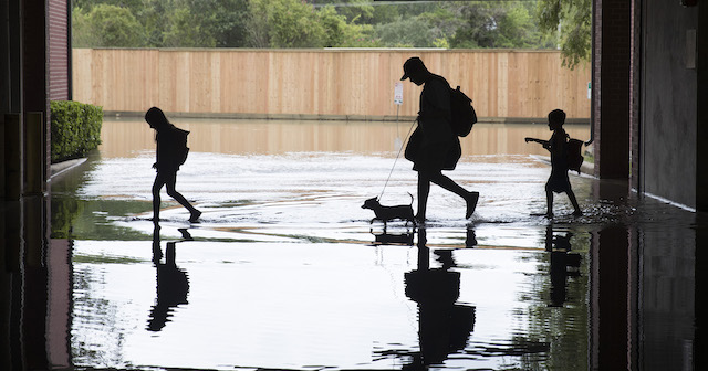 The Martinez family evacuates the apartment complex they live in near the Energy Corridor of west Houston, Texas where high water coming from the Addicks Reservoir is flooding the area after Hurricane Harvey