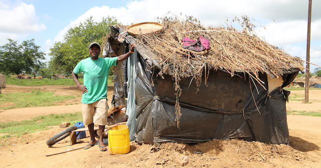 Malawian Man with the home he built