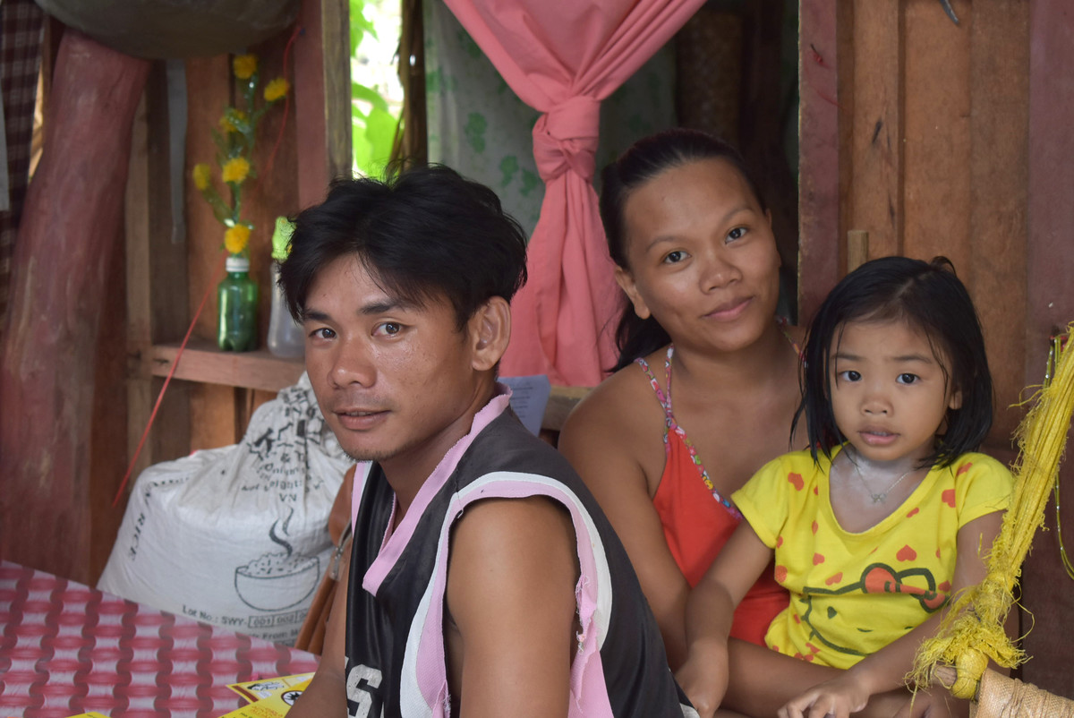 Family poses following Typhoon Vongfong
