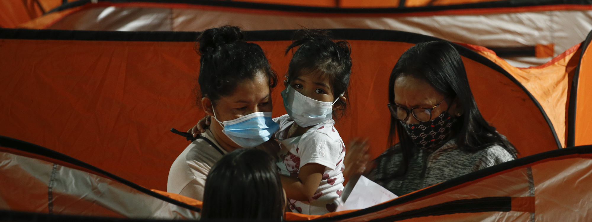 Wearing masks in the Philippines after typhoon Goni