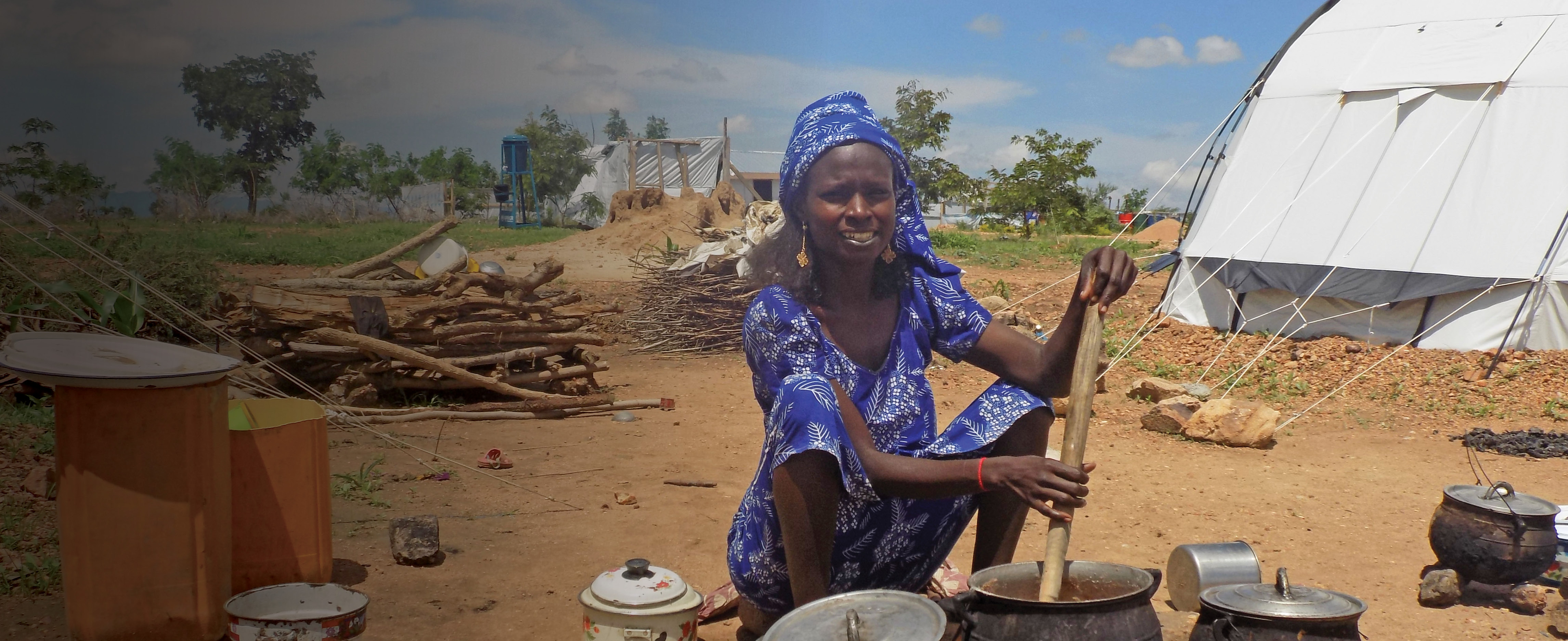 Cameroonian Woman with Cookware