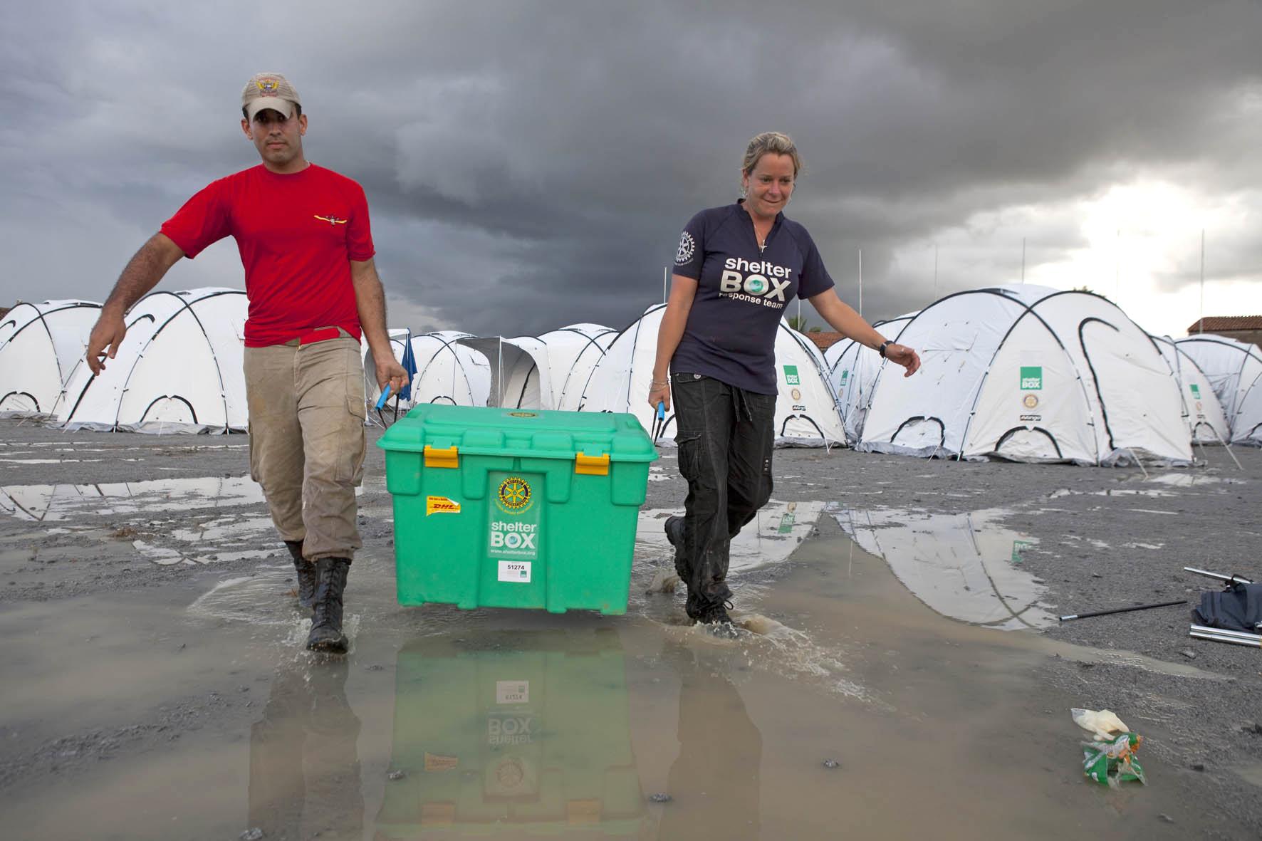 SRT Jodie Hurt (UK) with a Brazilian at Shelterbox camp at Uniao Dos Palmares, Alegoas, Brazil