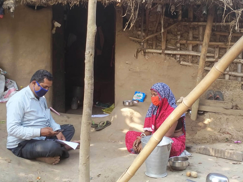 A Habitat for Humanity staff member conducting community consultations ahead of distributions.