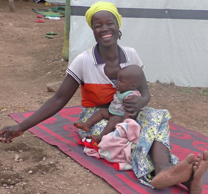 Kaltoumi holding her child